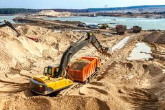 Excavator Loading Dumper Truck Royalty Free Stock Images