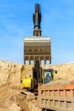 Excavator Loading Dumper Truck Royalty Free Stock Photo