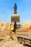 Excavator Loading Dumper Truck Stock Images