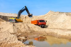 Excavator Loading Dumper Truck Royalty Free Stock Image