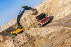 Excavator Loading Dumper Truck Stock Photo