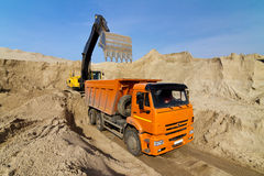 Excavator Loading Dumper Truck Stock Photography