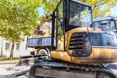 Excavator loading dumper truck. Stock Photography