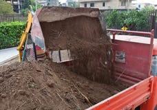 Excavator loading dumper truck tipper Stock Images
