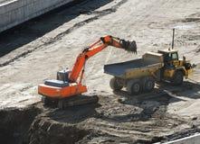 Excavator loading dumper truck tipper Royalty Free Stock Photos