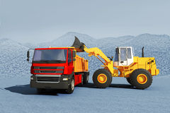 Excavator loading gravel on truck Royalty Free Stock Images