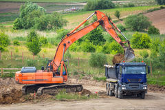 An excavator loading ground Stock Photos