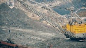 Excavator loading of iron ore on train stock video footage