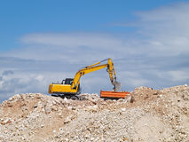 Excavator loading tipper truck Stock Photos