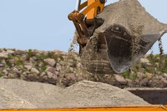 Excavator is loading the track. Constraction scene Stock Images