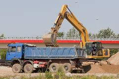 Excavator loading a truck Royalty Free Stock Photography