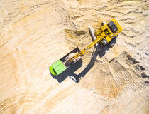 Excavator loading a truck. Royalty Free Stock Photo