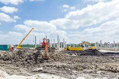 Excavator is loading a truck on building site Stock Photos