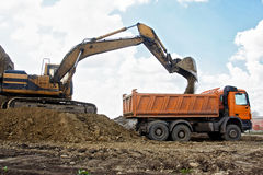 Excavator loading truck Royalty Free Stock Photography