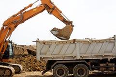 Excavator loading truck Stock Image