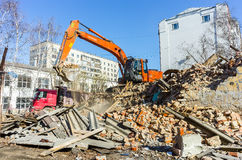 Excavator loads garbage from demolished house Stock Photography