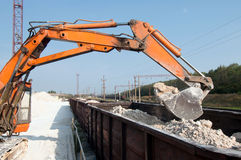 Excavator loads gravel Stock Images