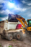 Excavator loads gravel Stock Photography