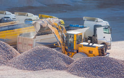 Excavator loads gravel Royalty Free Stock Photo