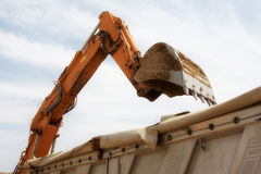 Excavator loads sand Stock Photography