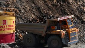 Excavator loads a stone in the heavy truck in the quarry mining granite stock video footage