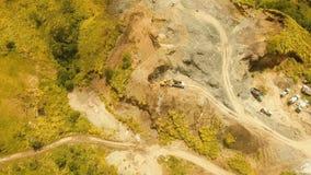 Excavator loads truck in quarry. Philippines,Bohol. stock video