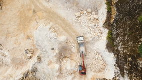 Excavator loads truck in quarry. Philippines,Siargao. stock video