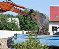 Excavator loads a truck Stock Photos