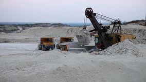 Excavator loads a truck rock in the quarry. Excavator loads a truck rock the quarry stock video footage
