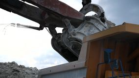 Excavator loads a truck rock in the quarry. Excavator loads a truck rock the quarry stock footage