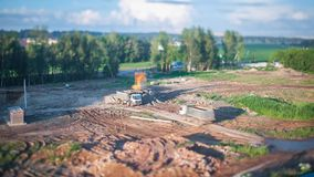 Excavator Loads a Truck, Tilt-Shift Time Lapse stock video