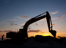 Excavator machine doing earthmoving Royalty Free Stock Photos