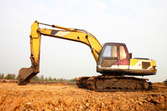 Excavator machine during earthmoving works Royalty Free Stock Photography