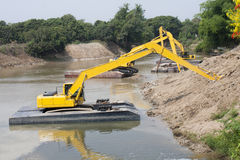 Excavator machine group works at river Stock Photography