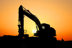 Excavator machine. Heavy excavator machine in the morning light royalty free stock photography