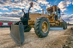 Excavator machine leveling the ground with a large shovel stock photography