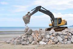 Excavator machine moves with raised bucket Stock Photos