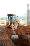 Excavator Machine used for earthwork at the construction site. Excavators are heavy construction machine used at the construction site to do the earthworks Royalty Free Stock Photo