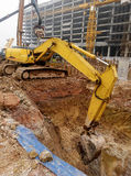 Excavator Machine used to excavate soil at the construction site. SELANGOR, MALAYSIA – SEPTEMBER 05, 2014: Excavators is heavy construction machine used stock photo