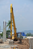 Excavator Machine used to excavate soil at the construction site. SELANGOR, MALAYSIA -APRIL 25, 2016: Excavators machine is heavy construction machine used stock photos