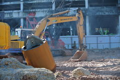 Excavator Machine used to excavate soil at the construction site. SELANGOR, MALAYSIA -APRIL 25, 2016: Excavators machine is heavy construction machine used stock images