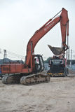 Excavator Machine used to excavate soil at the construction site Stock Photo