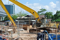 Excavator Machine used to excavate soil at the construction site. SELANGOR, MALAYSIA -APRIL 25, 2016: Excavators machine is heavy construction machine used royalty free stock images
