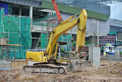 Excavator Machine used to excavate soil at the construction site. SELANGOR, MALAYSIA -JANUARY 02, 2016: Excavators is heavy construction machine used to do soil royalty free stock photo