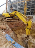 Excavator Machine used to excavate soil at the construction site. SELANGOR, MALAYSIA -JANUARY 02, 2016: Excavators is heavy construction machine used to do soil royalty free stock photos
