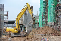 Excavator Machine used to excavate soil at the construction site. SELANGOR, MALAYSIA -JANUARY 02, 2016: Excavators machine is heavy construction machine used to royalty free stock images