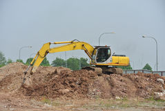 Excavator Machine used to excavate soil at the construction site. SELANGOR, MALAYSIA -JANUARY 02, 2016: Excavators machine is heavy construction machine used to royalty free stock image