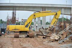 Excavator Machine used to excavate soil at the construction site. SELANGOR, MALAYSIA -JANUARY 02, 2016: Excavators machine is heavy construction machine used to stock images