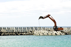 Excavator machine working. Heavy excavator machine in a pier construction site Stock Image