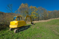 Excavator in a meadow Royalty Free Stock Photos